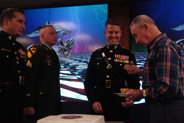 As is customary, the first piece of cake was presented to Mr. Philip Stotelmyer (right), the oldest Marine present, as a sign of respect and admiration for his honorable and faithful service to the Marine Corps.
