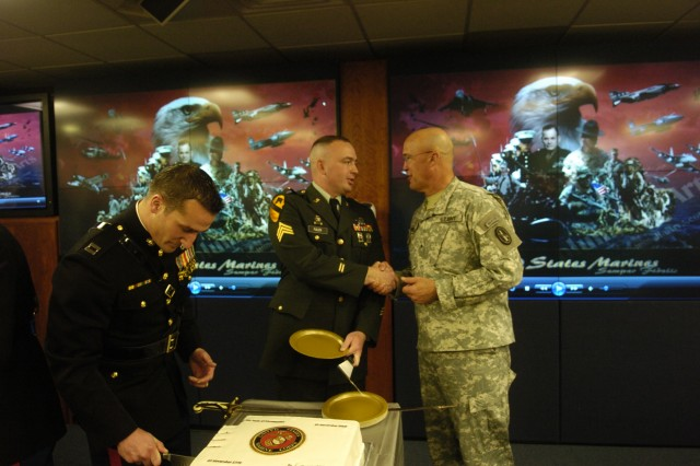 Brig. Gen. Horst meets with Sgt. Lonnie Fullen, the youngest Marine present at the celebration.  Capt. Adam Hoffman (left) cuts the birthday cake.
