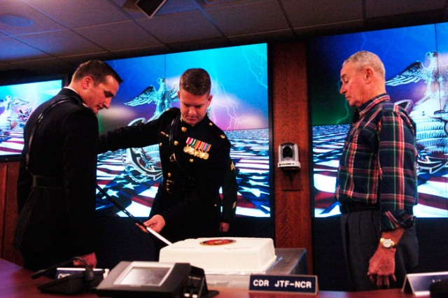 MAJ Tom Favor  performs the long-honored tradition of the Marine Corps Birthday Cake Cutting Ceremony.