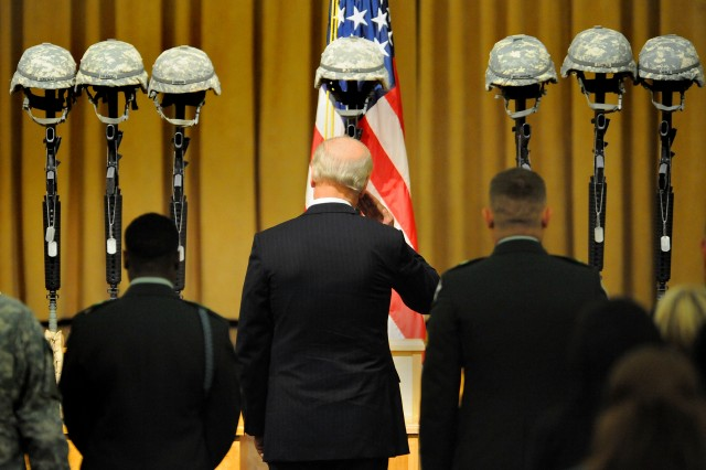 Vice President Joe Biden salutes seven Soldiers who were memorialized during a ceremony on Fort Lewis, Wash., Nov. 10. Staff Sgt. Luis M. Gonzalez, of South Ozone Park, N.Y.; Sgt. Fernando Delarosa, of Alamo, Texas; Sgt. Dale R. Griffin, of Terre Haute, Ind.; Sgt. Issac B. Jackson, of Plattsburg, Mo.; Sgt. Patrick O. Williamson, of Broussard, La.; Spc. Jared D. Stanker, of Evergreen Park, Ill., and Pfc. Ian Walz, of Vancouver, Wash., all with 1-17 Inf., 5th Bde., 2nd Inf. Div., were killed when an IED destroyed their Stryker vehicle in Afghanistan, Oct. 27.