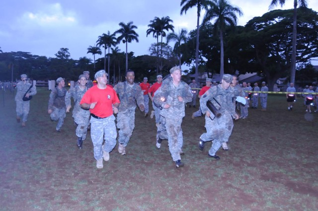 Soldiers from the 34th Sapper Company rush to the finish line during the Super Sappre Competition Nov. 5 at Schofield Barracks.
