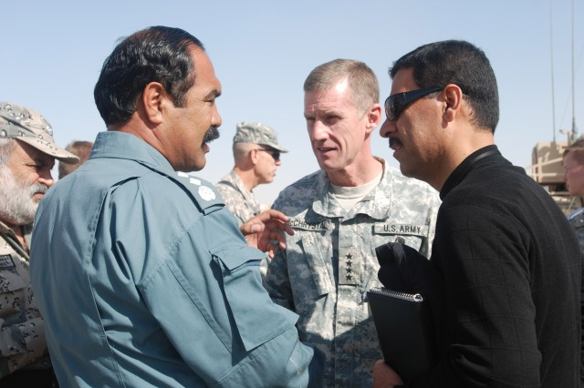 Gen. Stanley McChrystal (center) speaks with Afghan National  Police and Afghan Border Police Nov. 6 during a visit to Kandahar Air Field. (U.S. Army photo by Maj. Michelle Baldanza)