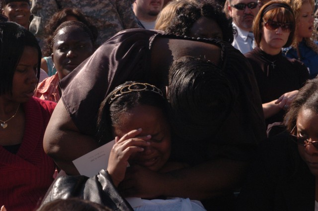 A woman breaks down crying during a memorial ceremony honoring 13 Fort Hood shooting victims outside the III Corps headquarters building on Fort Hood, Texas, Nov. 10. An estimated 15,000 attended the memorial.