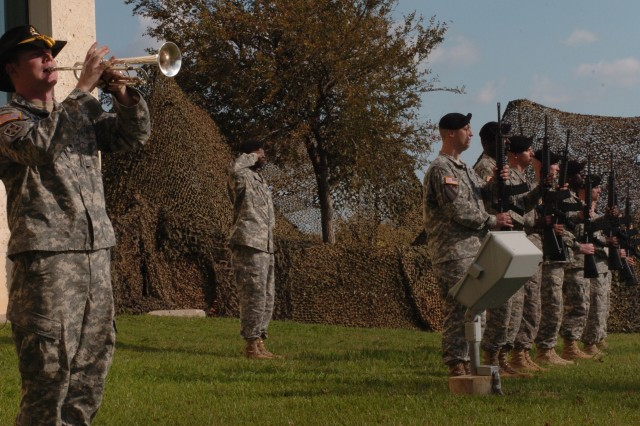 A 1st Cavalry Division bugler plays 'Taps' at the conclusion of a memorial ceremony honoring 13 Fort Hood shooting victims, Nov. 10, outside of the III Corps headquarters building on Fort Hood, Texas. More than 15,000 attended the memorial.