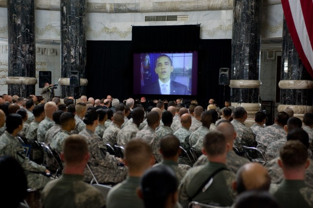 President Barack Obama sends a message of thanks and praise to 157 Soldiers and Marines who became America's newest citizens in a ceremony at Al Faw Palace in Baghdad, Iraq, on Veterans Day.