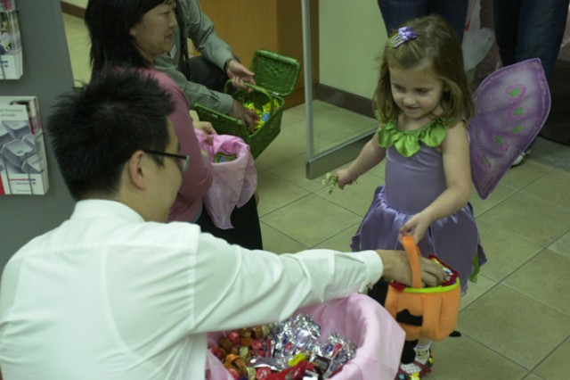 Children trick-or-treat on Red Cloud at the Pear Blossom Cottage
