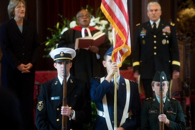 Cadets with the Reserve Officer Training Corps of Harvard University present the American flag at the beginning of a Veterans Day ceremony in Cambridge, Mass., Nov. 11, 2009. The ceremony was held to unveil a plaque containing 16 Harvard alumni who are Medal of Honor recipients.