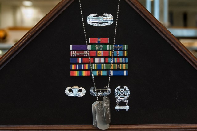 A shadow box displays some of the medals and badges awarded to Sgt. 1st Class Jared Monti at a Veterans Day reception in Buzzards Bay, Mass., Nov. 11, 2009. Monti was killed in action in Afghanistan on June 21, 2006, while trying for the third time to rescue a wounded fellow soldier.
