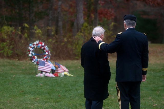 Paul Monti, father of Medal of Honor recipient Jared C. Monti, and Army Chief of Staff Gen. George W. Casey Jr. stand near Sgt. 1st Class Monti's gravesite on Veterans Day at the Mass. National Ceremony in Bourne, Mass., Nov. 11, 2009. Sgt. 1st Class Jared C. Monti was posthumously awarded the nation's highest award for valor, the Medal Of Honor.