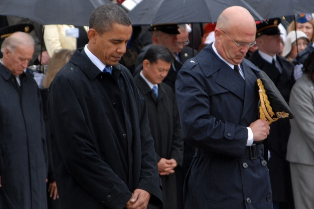 Pres. Barack H. Obama and Brig. Gen. Karl Horst, commander of the Military District of Washington, stand before the Tomb of the Unknown Soldier in a moment of reflection for the contribution of the American veteran.