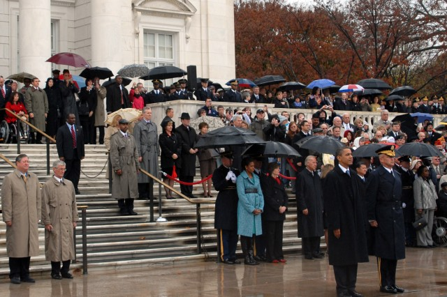 President Barack H. Obama, Brig. Gen. Karl Horst, and others stand on the plaza of the Tomb of the Unknown Soldier at Arlington National Cemetery on Veteran's Day.  The president and thousands of other Americans were at Arlington  National Cemetery to commemorate Veteran's Day.