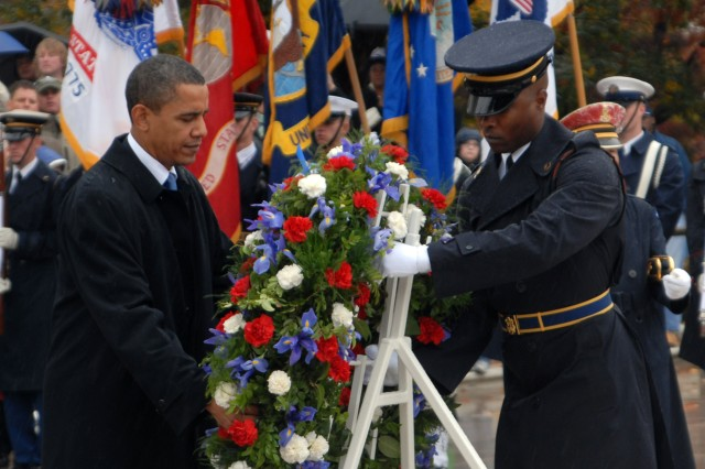President Barack H. Obama presents a wreath at the Tomb of the Unknown Soldier in Arlington National Cemetery.  Commander of the Guard Sgt. 1st Class Alfred Lanier assists the president in laying the wreath.  ""