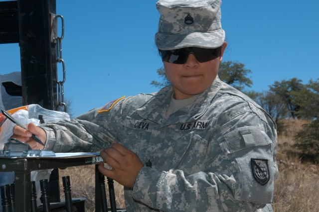 Staff Sgt. Rosy Cueva, information technology specialist, Network Enterprise Technology Command/9th Signal Command (Army), prepares to issue weapons to Soldiers competing in the unit's Noncommissioned Officer/Soldier of the Year competition, June 16, 2009.