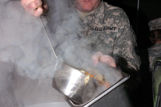 ALTOONA, Pa.-  Spc. Robet Lamborn, of East Freedom, Pa., a food service specialist with the 298th Maintenance Company here, prepares to serve minestrone soup during the Philip A. Connelly Awards competition for Field Kitchen at Fort Roberdeau, Pa., Nov. 7.  Lamborn was part of the 298th MC Co. team that was awarded U.S. Army Reserve Runner-up for Best Army Reserve Kitchen. (U.S. Army photo by Sgt. Crystal Adamosky)