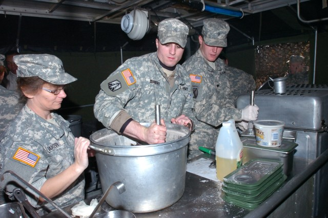 Sgt. Jonathan Odrosky, of Houtzdale, Pa., a food service specialist with the 298th Maintenance Company here, mixes ingredients and prepares icing during the Philip A. Connelly competition for Field Kitchen at Fort Roberdeau, Pa., Nov. 7.