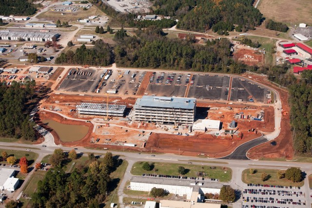 Progress on the Army Materiel Command and U.S. Army Security Assistance Command headquarters on Martin Road is coming along at a quick pace. This aerial photo shows the front of the AMC/USASAC buildings with Martin Road in the foreground. The building complex, which is among more than $565 million in ongoing Arsenal construction, is set to be complete in March 2011.