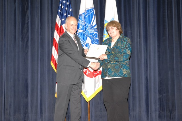 Scott F. Miller, Deputy Director of Training, HQDA Office of the Deputy Chief of Staff G-3/5/7, presents Evelyn Pool a certificate at the Civilian Education System Advanced Course closing ceremony Oct. 30 at Army Management Staff College, Fort Belvoir, Va.