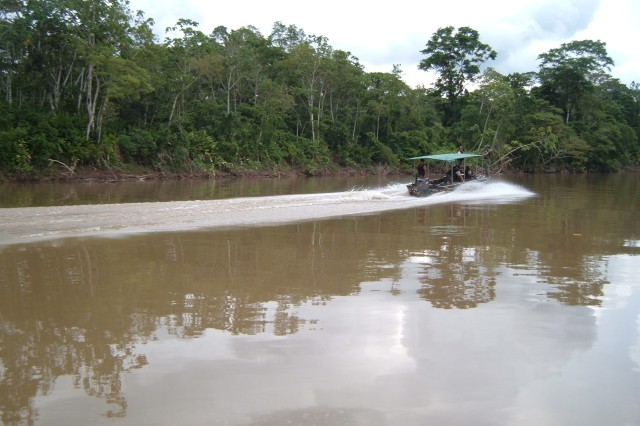 "Soldiers with the Ecuadorian Army 4th Division ""Amazonas"" patrol the Payamino River in a PiraAfA+-a, a river patrol boat. Members of the Ecuadorian Army patrol the rivers of Ecuador in order to protect their border and prevent the flow of"