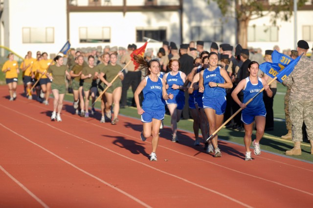 Teams from all four branches of the military compete in a two-mile race while in formation and carrying a guidon in an effort to claim the Commander's Cup. The service branch with the best men's and women's combined time earn the honor to take home the prestigious Cup--keeping it until the next race is held.