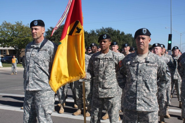 """Col. Brian Winski, commander, 4th Brigade Combat Team, 1st Cavalry Division, and Command Sgt. Major Edwin Rodriguez, senior enlisted leader for 4th BCT, along with unit members assigned to the """"Long Knives"""" brigade stand at parade rest just seconds before the brigade participated in a moment of silence at Fort Hood Nov. 6.  The moment took place exactly one day after a civilian and 12 Soldiers were killed Nov. 5 during a shooting near the base's Soldier Readiness Processing Center."""
