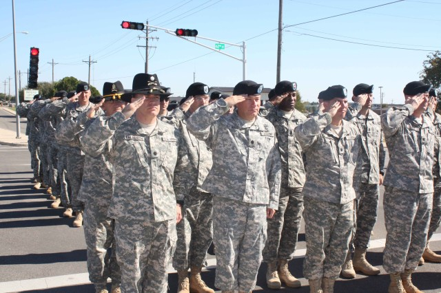 """Unit members, assigned to the 4th Brigade Combat Team, 1st Cavalry Division """"Long Knives"""" render a salute during a moment of Silence at Fort Hood Nov. 6. The moment took place exactly one day after a civilian and 12 Soldiers were killed Nov. 5 during a shooting near the base's Soldier Readiness Processing Center."""