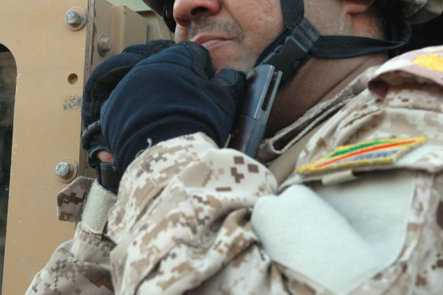 BAGHDAD - Maj. Firas, commander of the 2nd Company, 4th Battalion, 36th Iraqi Army Brigade, sends a report to his higher headquarters in Tarmiyah, Nov. 7.