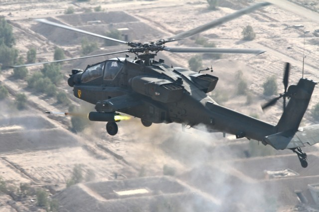 BAGHDAD-Producing a blast of smoke and fire, an AH-64D Apache attack helicopter pilot from 1st Air Cavalry Brigade, 1st Cavalry Division, fires a 2.75 inch hydra aerial folding-fin rocket while conducting a gunnery on the outskirts of Baghdad, Nov. 9.