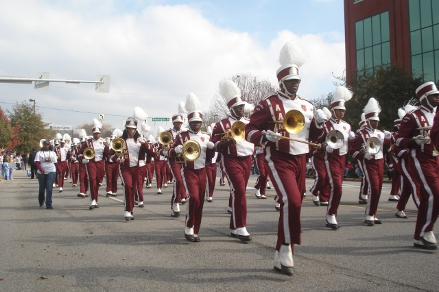 The Alabama A&M University marching band leads the parade entries as they take a momentary break between musical selections.  This unit was one of seven marching bands that participated in this year's North Alabama Veterans Day Parade Nov. 11 in downtown Huntsville.