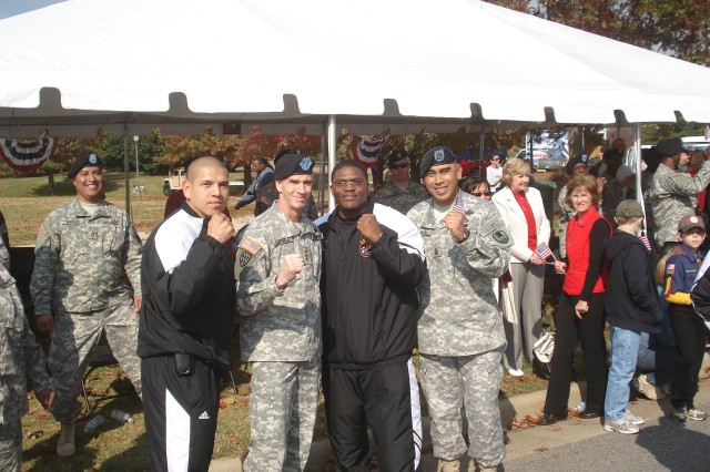 LTG Kevin T. Campbell (2nd from left), commanding general, U.S. Army Space and Missile Defense Command/Army Forces Strategic Command and his Command Sergeant Major, CSM Ralph Borja, (far right), pose with two amateur boxers during this year's North Alabama Veterans Day Parade conducted Nov. 11 in downtown Huntsville, Ala. The boxers are part of the First Veterans Classic scheduled for Nov. 14, featuring the U.S. Army versus the Southeast All-Stars in the VBC's South Hall 2.  LTG Campbell was the reviewing officer for the parade.