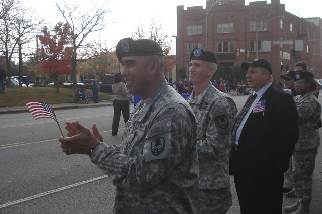 LTG Kevin T. Campbell (right), commanding general, U.S. Army Space and Missile Defense Command/Army Forces Strategic Command and his Command Sergeant Major, CSM Ralph Borja, (left), applaud one of the more than 100 entries in this year's North Alabama Veterans Day Parade conducted Nov. 11 in downtown Huntsville, Ala. LTG Campbell was the reviewing officer for the parade.