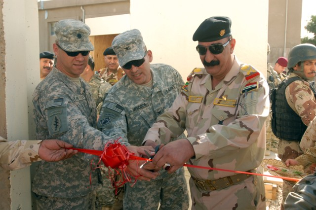 Maj. Gen. Abdul Ameer, the commander of the 12th Iraqi Army Division, cuts the ribbon to the new joint tactical operations center for the 12th Field Engineer Regiment on K-1 Military Base in Kirkuk province, Iraq, Nov. 8. The new J-TOC will allow the 12th FER to work more closely with their U.S. Military counterparts.