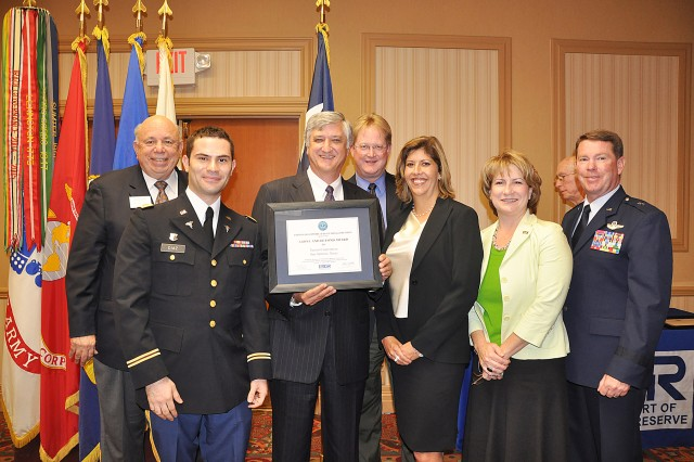 """FORT SAM HOUSTON, Texas -- The Employer Support of the Guard and Reserve Salute to Bosses Awards luncheon recognizes civilian employers, nominated by their employees, who have gone above and beyond supporting them while performing their duties in the guard and reserves. Keynote speaker, Brig. Gen. John Nichols, Texas Assistant Adjutant General Air, Texas National Guard, said, """"I am an employer, I mobilize people, my boss is the Governor, so I stand on both sides."""" Nichols thanked the civilian employees for seeing how important their support is of the men and women in the guard and reserve. The luncheon, held Nov. 4 at the Holiday Inn Select, San Antonio, presented the Above and Beyond Awards to Chase Card Services, Tesoro Corporation, Toyota Motor Manufacturing, Texas, Inc., Department of Public Safety - Devine, HEB Dairy, North East Methodist Hospital and South Texas Veterans Health Care System."""
