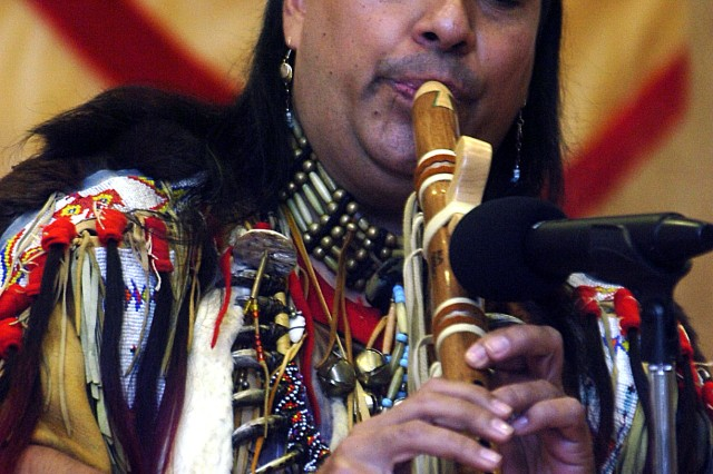 Chief Red Iron Hawk performs on a wood-carved flute during Fort Belvoir's American Indian Heritage Month celebration at the post's Community Center Nov. 12. President Obama proclaimed November as National Native American Heritage Month.