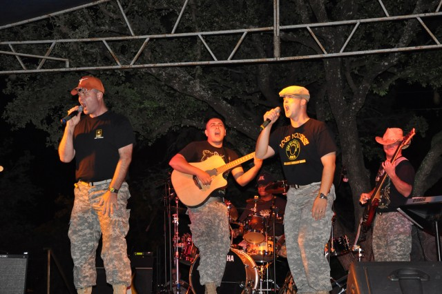 """The """"Surgical Strike"""" band, members of the Army Medical Command Band, rock the crowd at the San Antonio Botanical Garden Nov. 6."""