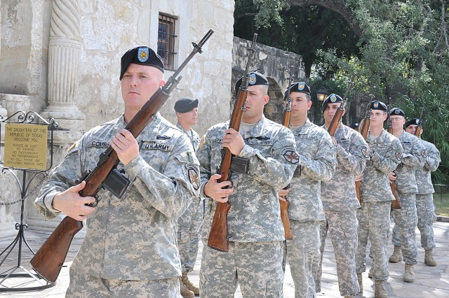 Members of the rifle platoon, Headquarters and Headquarters Company, U.S. Army Garrison, Fort Sam Houston prepare for the gun volley at the Veterans Day wreath presentation held in front of the Alamo Nov. 7.