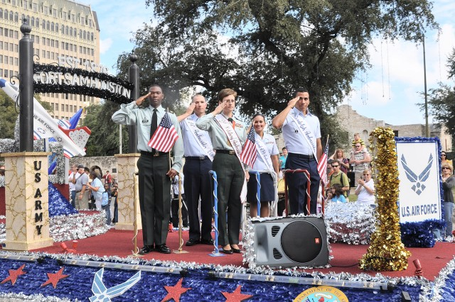 Staff Sgt. Erin Hicks, (front) with Army and Air Force military ambassadors salute as they pass the reviewing stand at the Alamo during the San Antonio Veterans Day Parade. The Military Float won first place in the Best Float category.