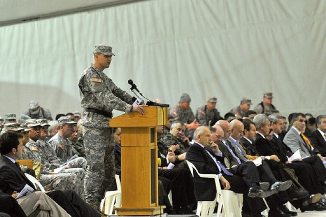 Kosovo Forces 12 Multi-National Task Force-East Commanding General Brig. Gen. Alan S. Dohrmann speaks to distinguished visitors, guests and the troops of KFOR 12 MNTF-E during the transfer-of-authority ceremony Nov. 14 at Camp Bondsteel, Kosovo.