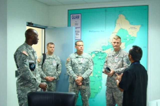 Mr. James Cruz (far right) of Joint Task Force - Homeland Defense (JTF-HD) answers questions from members of the 94th Army Air and Missile Defense Command (AAMDC) regarding the standing up of the Missile Defense Task Force on Guam.  The members are: (from right) Col. (P) Jeff Underhill, commanding general, Col. James Spangler, operations officer, Maj. Donald Woodworth, logistics plans officer, and Command Sgt. Maj. Phillip Rowland.