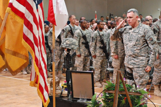 Major General John Johnson, the deputy commanding general for operations for Multi-National Corps-Iraq, salutes a memorial in honor of Pvt. Francheska Velez, who died in a tragic shooting on Fort Hood, Texas, Nov. 5. The ceremony took place on Forward Operating Base Warrior, Kirkuk, Iraq, and was attended by Pvt. Velez's peers.