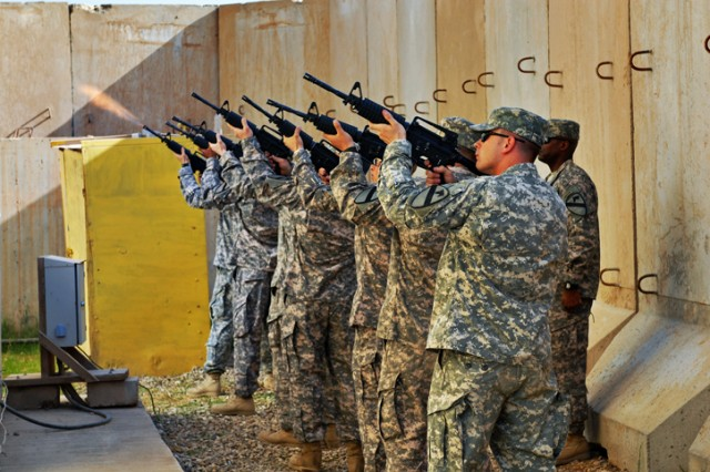 Soldiers from Pvt. Francheska Velez's unit fire a 21-gun salute at a memorial in her honor on Forward Operating Base Warrior, Kirkuk, Iraq, Nov. 13. Velez was killed during a tragic shooting on Fort Hood, Texas, Nov. 5.