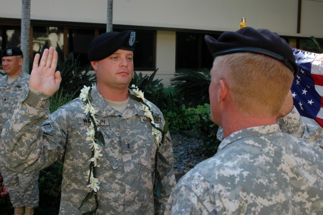 HICKAM AIR FORCE BASE, Hawaii- Newly promoted, Chief Warrant Officer Timothy Watson, senior intelligence technician, 94th Army Air and Missile Defense Command, recites his oath to service as a warrant officer in the U.S. Army at the historic Pacific Air Force Headquarters, here, 16 Nov.