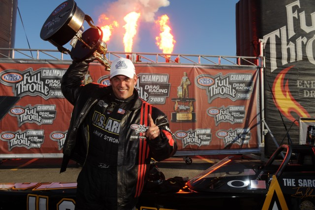 """Tony """"the Sarge"""" Schumacher accepts the championship trophy in Pomona, Calif."""