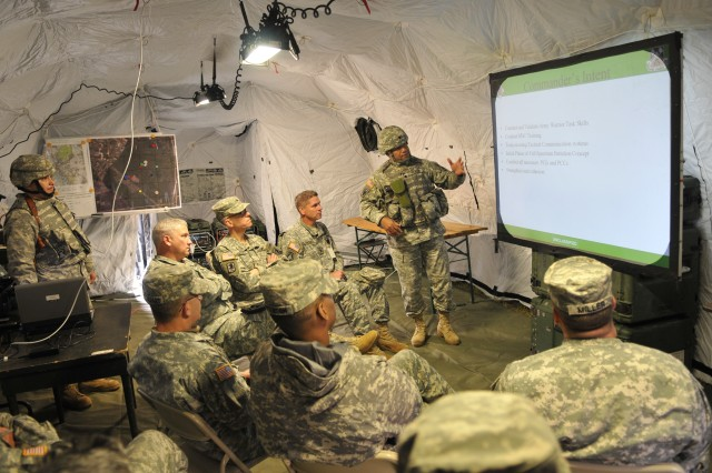 """MANNHEIM, Germany (Nov. 3, 2009) --Lt. Col. Laroy Peyton, 43rd Signal Battalion commander, briefs distinguished visitors at the Lampertheim Training Area during a """"Full Spectrum"""" signal summit Nov. 3-5 hosted by 5th Signal Command."""