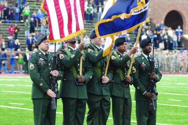 An all-Army color guard from Fort Eustis, Va., renders honors during the singing of the nation anthem at the Nov. 14 college football game between the William and Mary Tribe and the New Hampshire Wildcats at Zable Stadium in Colonial Williamsburg. About 100 Soldiers attended the Military Appreciation Day event.  Pictured from left to right are: Staff Sgt. Jonathan Betancourt, Staff Sgt. John Johnson, Staff Sgt. Douglas Carlile, Staff Sgt. Lateaf Thomas, and Staff Sgt. Blair Pierce.