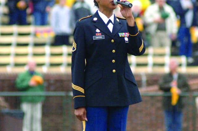 Staff Sgt. Patricia Conyers from the U.S. Army Training and Doctrine Command Band at Fort Monroe, Va., sings the national anthem during the opening ceremony of a Nov. 14 college football game between the William and Mary Tribe and the New Hampshire Wildcats at Zable Stadium in Colonial Williamsburg. About 100 Soldiers attended the Military Appreciation Day event; they included Advanced Individual Training troops from Fort Eustis and ROTC students from William and Mary.