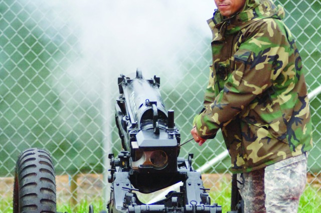 Spc. Jason Leacock, a member of the U.S. Army Training and Doctrine Command Salute Battery at Fort Monroe, Va., accentuates a home-team touchdown with cannon fire during the Nov. 14 college football game between the William and Mary Tribe and the New Hampshire Wildcats at Zable Stadium in Colonial Williamsburg. About 100 Soldiers attended the Military Appreciation Day event. Also participating from the TRADOC Salute Battery was Sgt. 1st Class Kliean Elwin.