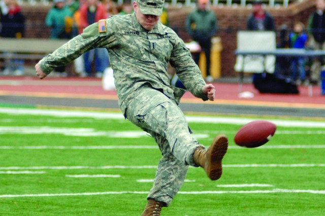 ROTC Cadet Justin Sheppard from the College of William & Mary tries to kick a field goal during the halftime program of a Nov. 14 football game between the William and Mary Tribe and the New Hampshire Wildcats at Zable Stadium in Williamsburg, Va. About 100 Soldiers attended the Military Appreciation Day game. Sheppard was one of three contestants who participated in the halftime kick-off for free round-trip airfare to anywhere in the country. Unfortunately, the future Army officer missed the uprights and didn't win the tickets.
