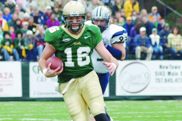 William and Mary Tribe quarterback R.J. Archer turns a busted pass play into a short gain during the Nov. 14 CAA (College Athletic Association) football game between the fourth-ranked Tribe and the seventh-ranked New Hampshire Wildcats at Zable Stadium in Williamsburg, Va. The Tribe welcomed nearly 100 Soldiers to the Military Appreciation Day game. Partially powered by the cheers of the participating troops, the home team accomplished a 20-17 win and moved their win-loss total to 9-1 for the first time since 1947.