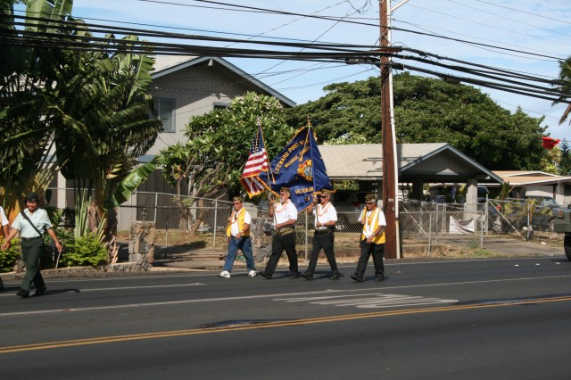 WAIANAE, Hawaii -Veterans of Foreign Wars, Leeward Post No. 849, display the colors during the 28th Annual Veterans Day Parade in Waianae. The Waianae Military Civilian Advisory Council (WMCAC) honored veterans and service members during its 28th Annual Veterans Day Parade and Hoolaulea (Hawaiian party), here, Nov. 7.