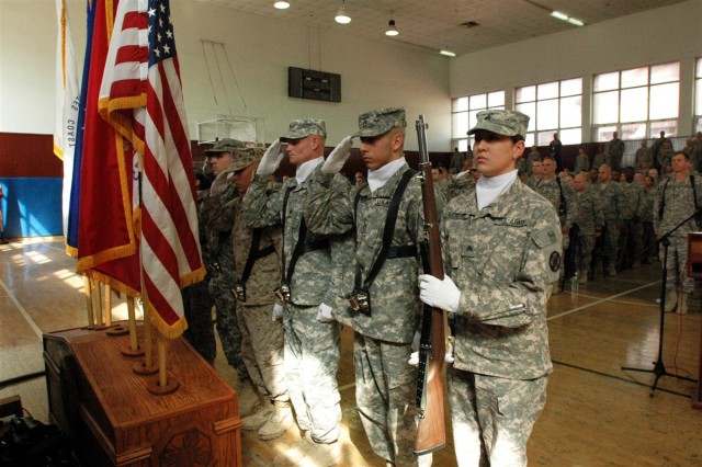 Members of the color guard render honors to the flag during the Veteran's Day Observance Nov. 11 here at Joint Base Balad.